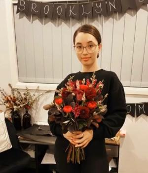 21-YEAR-OLD FLORIST IS BLOOMING MARVELLOUS